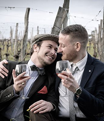 LGBT couple at their wedding that a Gateway Financial Advisor fit into their LGBT Financial Plan